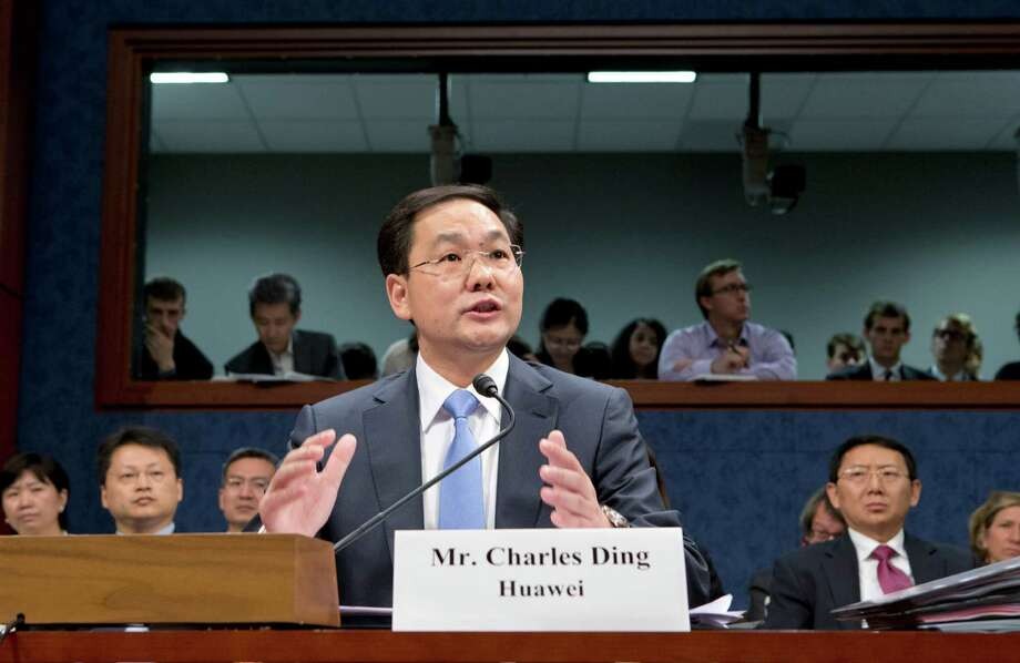 FILE - In this Sept. 13, 2012, Charles Ding, Huawei Technologies Ltd's senior vice president for the U.S., testifies on Capitol Hill in Washington, before the House Intelligence Committee as lawmakers probe whether Chinese tech giants' expansion in the U.S. market pose a threat to national security. In a report to be released Monday, Oct. 8, 2012, the House Intelligence Committee is warning that China's two leading technology firms pose a major security threat to the United States. The panel says regulators should block mergers and acquisitions in the U.S. by Huawei Technologies Ltd. and ZTE Corp. It also advises that U.S. government systems not include equipment from the two firms, and that private U.S. companies avoid business with them. (AP Photo/J. Scott Applewhite, File) Photo: J. Scott Applewhite / AP