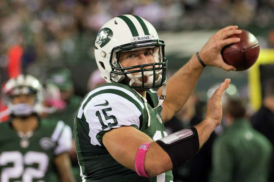 New York Jets quarterback Tim Tebow warms up before going into the game during the second quarter of a Monday Night Football game against the Houston Texans at MetLife Stadium on Monday, Oct. 8, 2012, in East Rutherford. Photo: Smiley N. Pool, Houston Chronicle / © 2012  Houston Chronicle