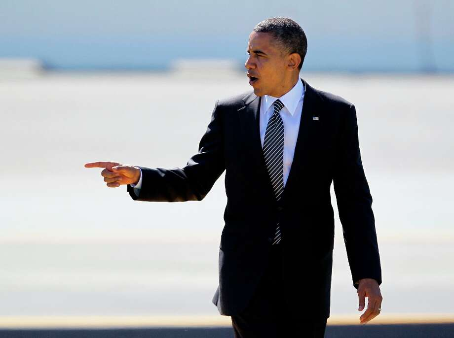 President Barack Obama gestures after arriving at San Francisco International Airport in San Francisco, Monday, Oct. 8, 2012. The President is spending the night in San Francisco campaigning and fundraising. (AP Photo/Eric Risberg) Photo: Eric Risberg, Associated Press / AP