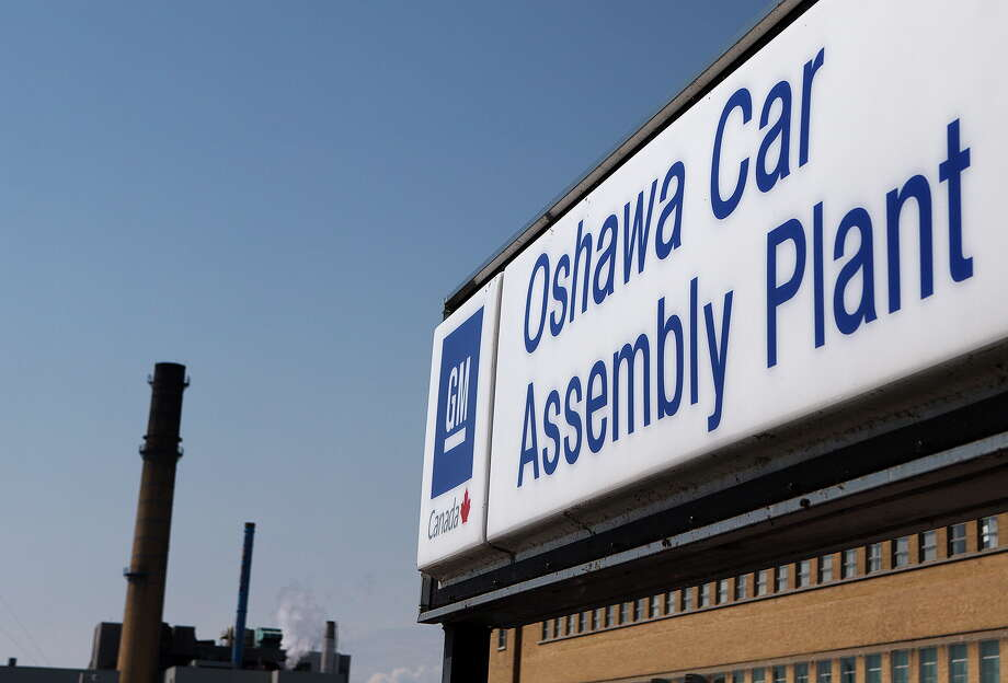 FILE-In this Monday, Sept. 17, 2012, file photo, a sign stands outside Oshawa's General Motors car assembly plant in Oshawa, Ontarrio. General Motors said Monday, Oct. 8, 2012,  it will hire as many as 1,500 workers to staff a new computer technology center in the Detroit suburb of Warren, Mich. GM is shifting computer work into the company from outside firms and plans to open four new technology centers in the U.S. Last month the company announced it would hire 500 people for a center in Austin, Texas.  (AP Photo/The Canadian Press, Michelle Siu) Photo: Michelle Siu / The Canadian Press