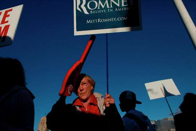 Romney supporter, Fran Cavenaugh, of Walnut Creeks, tries to send a message to Obama supporters at they wait for the president to arrive for a fundraiser at the Bill Graham Civic Auditorium on Monday Oct. 10, 2012 in San Francisco, Calif. Photo: Mike Kepka, The Chronicle / ONLINE_YES