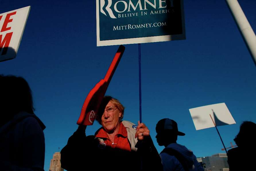 Romney supporter, Fran Cavenaugh, of Walnut Creeks, tries to send a message to Obama supporters at t