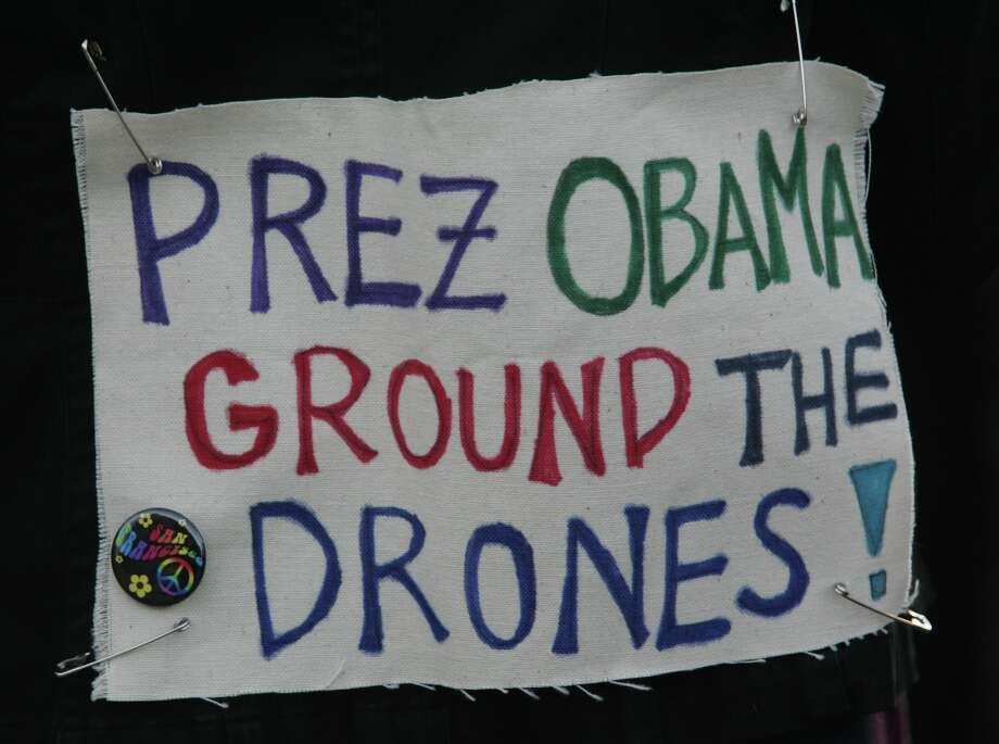 A war protester wears a sign outside a campaign event for President Barack Obama in San Francisco on Monday, Oct. 8, 2012. (AP Photo/Mathew Sumner) Photo: Mathew Sumner, Associated Press / FR170005 AP