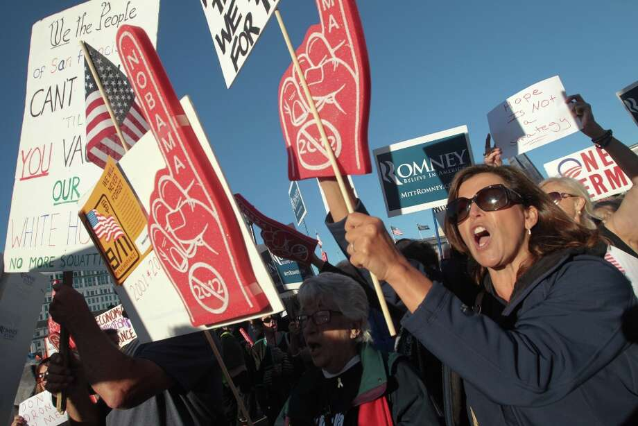 Liz Biagini and other Mitt Romney supporters chant anti-Obama slogans outside a campaign event for President Barack Obama in San Francisco on Monday, Oct. 8, 2012. (AP Photo/Mathew Sumner) (Associated Press) Photo: Mathew Sumner, Associated Press / FR170005 AP