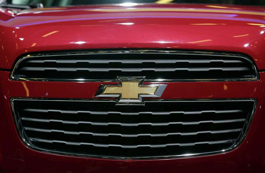 The Chevrolet logo marks the grill of a Trax SUV, produced by General Motors. GM is No. 1 for year-to-date retail sales in the Houston area. Photo: Jason Alden / Copyright 2012 Bloomberg Finance LP