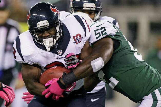 Houston Texans running back Justin Forsett (28) is tackled by New York Jets inside linebacker David Harris (52) during the first half of an NFL football game between the New York Jets and the Houston Texans Monday, Oct. 8, 2012, in East Rutherford, N.J. (AP Photo/Kathy Willens) Photo: Kathy Willens, Associated Press / AP