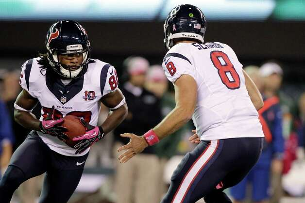 Houston Texans wide receiver Keshawn Martin (82) runs a reverse as he takes the ball from  Matt Schaub (8) during the first half of an NFL football game against the New York Jets Monday, Oct. 8, 2012, in East Rutherford, N.J. (AP Photo/Kathy Willens) Photo: Kathy Willens, Associated Press / AP