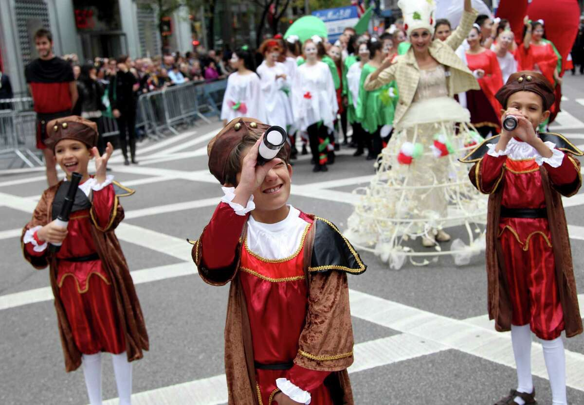 Children pretending to be explorers participate in the Columbus Day parade in New York, Monday, Oct. 8, 2012. (AP Photo/Seth Wenig)