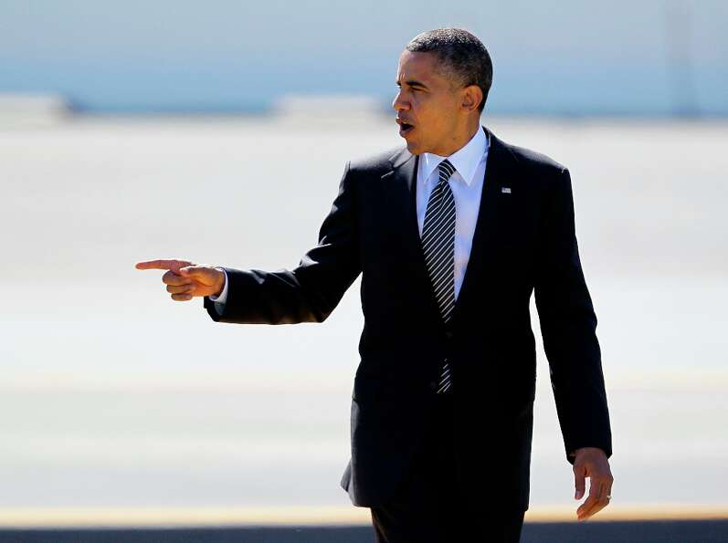 President Barack Obama gestures after arriving at San Francisco International Airport in San Francis