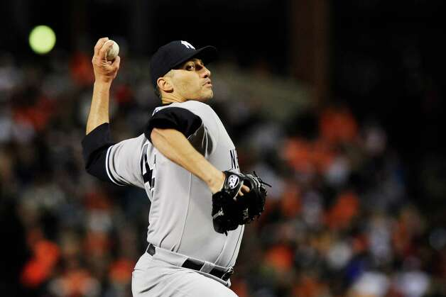 BALTIMORE, MD - OCTOBER 08:  Andy Pettitte #46 of the New York Yankees pitches in the first inning during Game Two of the American League Division Series against the Baltimore Orioles at Oriole Park at Camden Yards on October 8, 2012 in Baltimore, Maryland.  (Photo by Patrick McDermott/Getty Images) Photo: Patrick McDermott