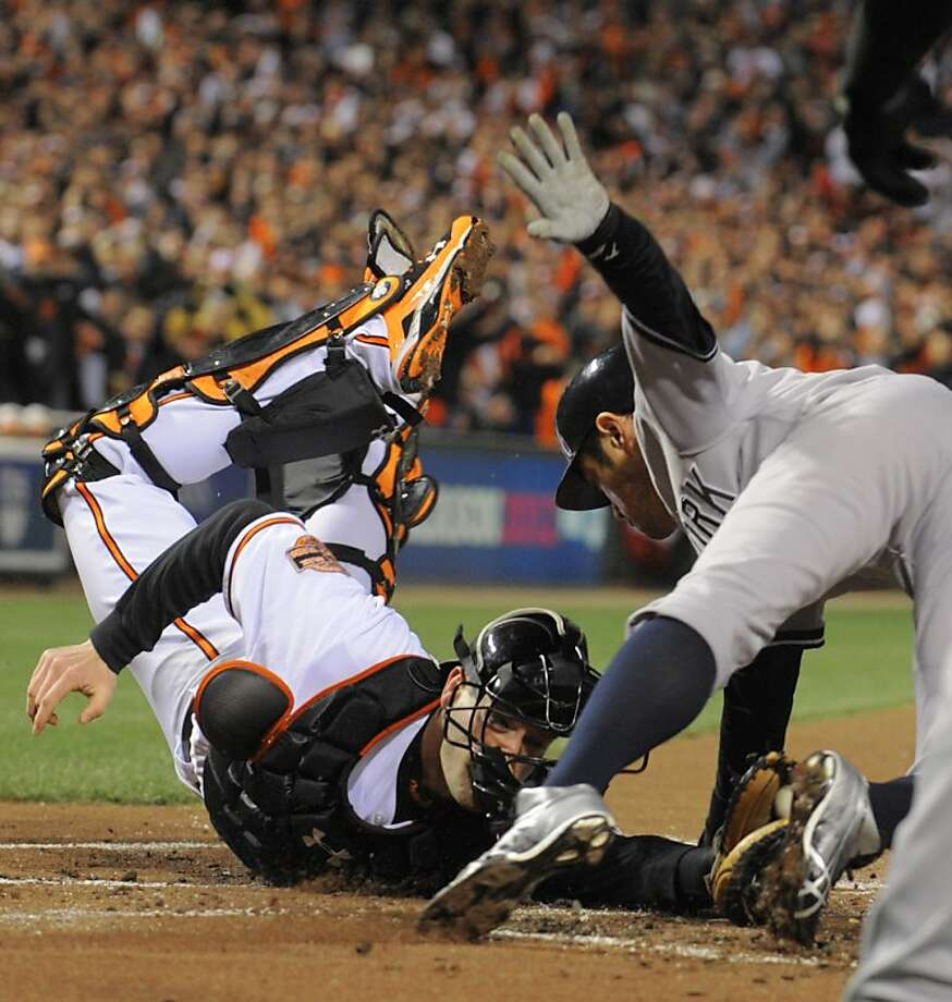 New York Yankees' Ichiro Suzuki touches the plate to score against Baltimore Orioles catcher Matt Wieters in the first inning during Game 2 of the American League Division Series at Oriole Park at Camden Yards in Baltimore, Maryland, Monday, October 8, 2012. (Karl Merton Ferron/Baltimore Sun/MCT) Photo: Karl Merton Ferron, McClatchy-Tribune News Service