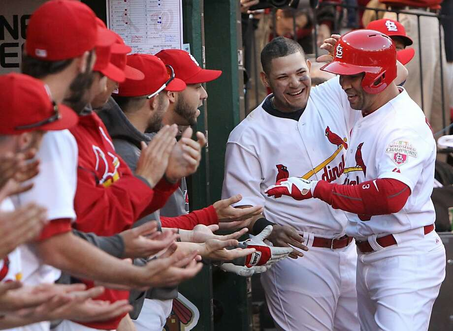 St. Louis Cardinals' Yadier Molina, second from right, congratulates Carlos Beltran who hit a solo home run in sixth inning action of Game 2 of the National League Division Series at Busch Stadium in St. Louis, Missouri on Monday, October 8, 2012. The St. Louis Cardinals defeated the Washington Nationals, 12-4. (Chris Lee/St. Louis Post-Dispatch/MCT) Photo: Chris Lee, McClatchy-Tribune News Service