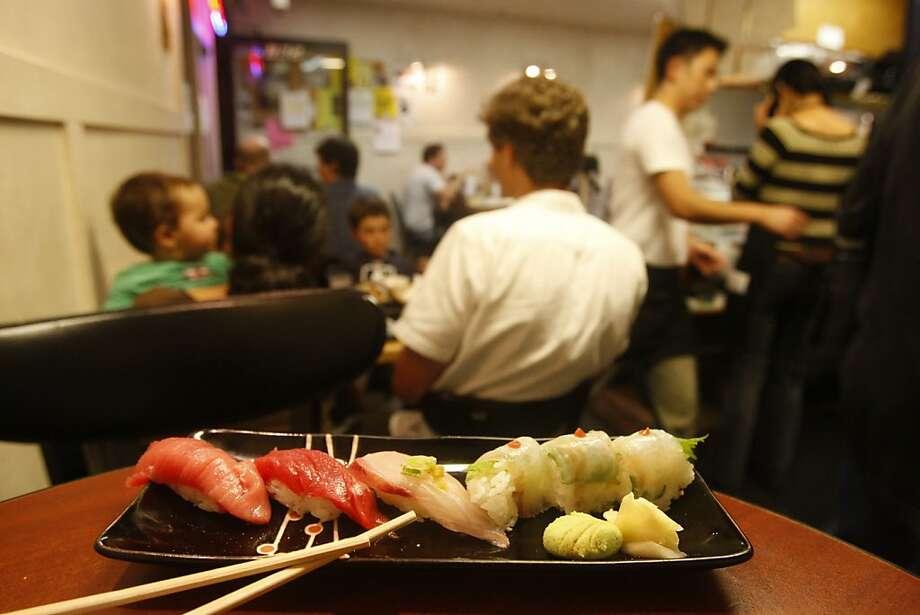 Toro (left), tuna, kanpachi and hirame at Geta, a popular Japanese restaurant in Oakland. Photo: Liz Hafalia, The Chronicle