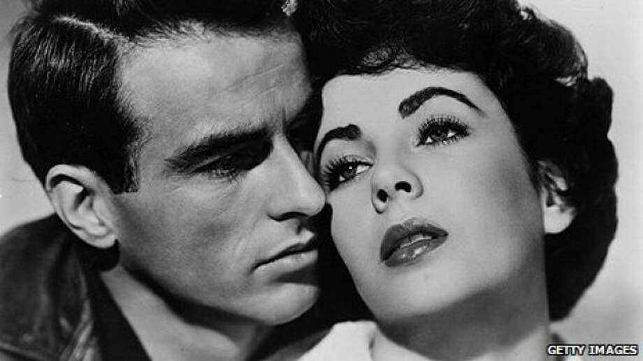 A PLACE IN THE SUN, with Montgomery Clift and Elizabeth Taylor.  He's poor and climbing, and she's the American dream.