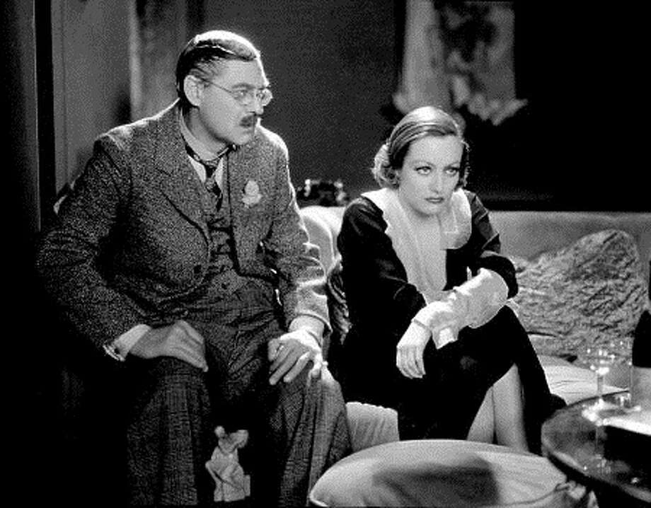 "Lionel Barrymore and Joan Crawford in ""Grand Hotel'' -- wonderful ensemble film, the best picture of 1932.  (SFC)"