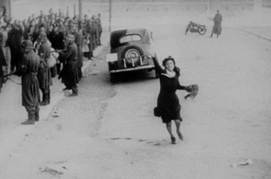 Anna Magnani in ROME OPEN CITY.  The first and one of the most powerful of the Italian neorealism films, shot as the Nazis were leaving Rome -- by Roberto Rossellini. (Criterion Collection)