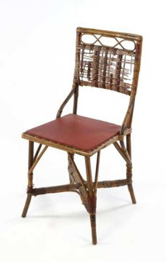 "Also up for auction: CASABLANCA CHAIR FROM RICK'S CAFÉ AMERICAN A bamboo and wicker chair used as set decoration in Rick's Café American owned by Rick Blaine, played by Humphrey Bogart in ""Casablanca"" (Warner Bros., 1942). These style bamboo framed, wicker covered chairs can be seen throughout the café during the film. The chair, stamped ""Made in Belgium"" on the bottom, was last purchased in the 1970's from a Los Angeles prop warehouse and is hand-inscribed with the following production/inventory markings: ""A 501-455,"" ""BS 4702,"" ""WH"" along with a faint pencil inscription of a name. The first name is unintelligible with a last name ""Brems."" The chair's wicker seat had been replaced with a painted wood panel. Estimate: $500 - $1,000 (Julien\\\\\\\'s Auctions)"
