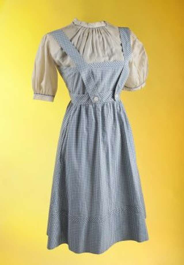 "The dress worn by actress Judy Garland in the classic film, ""The Wizard of Oz"" is up for auction. See more photos in this gallery."