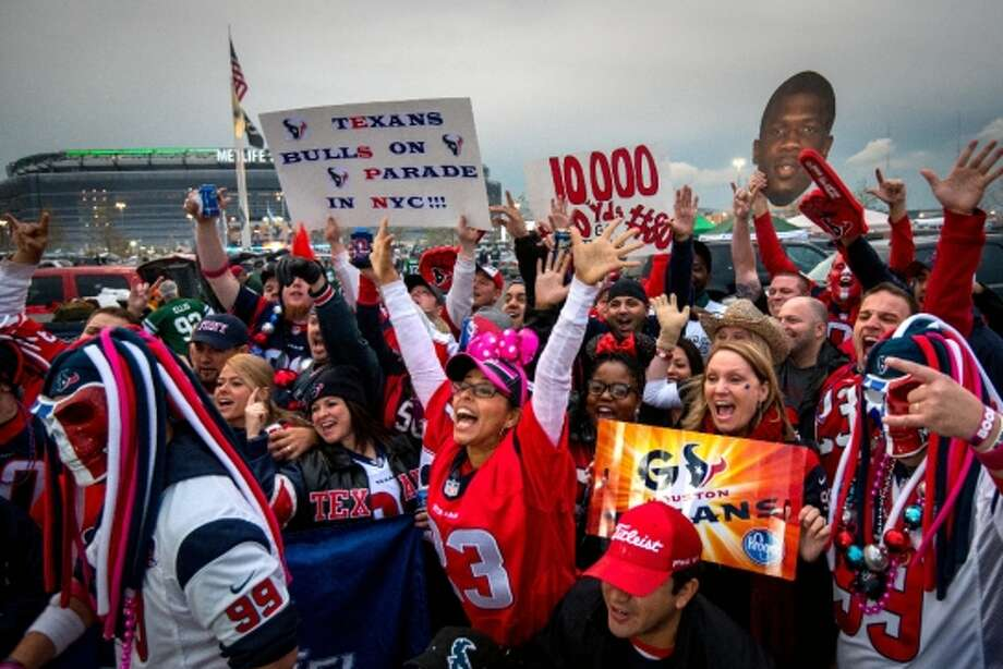 Texans fans whoop it up in the parking lot while tailgating before the Texans game against the New York Jets on Monday Night Football. (Houston Chronicle)