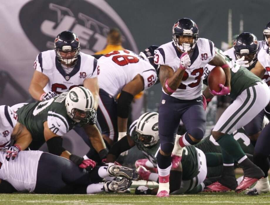 Texans running back Arian Foster (23) breaks free of the New York Jets defense during the first quarter. (Houston Chronicle)