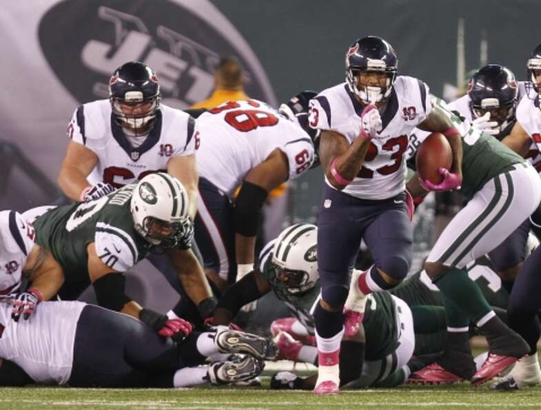 Texans running back Arian Foster (23) breaks free of the New York Jets defense during the first quar