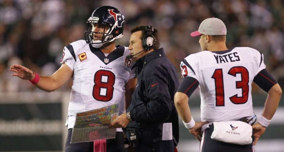 Texans quarterback Matt Schaub (8) walks to head coach Gary Kubiak, center, as T.J. Yates (13) stands by during the second half. (Houston Chronicle)
