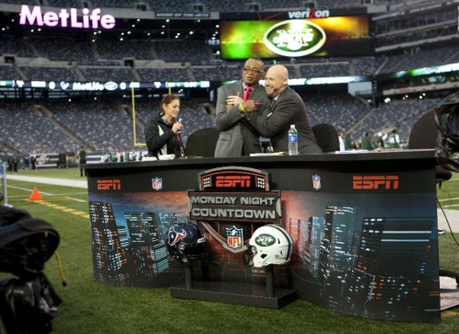ESPN's Stewart Scott, left, and Trent Dilfer pretend to be cold while preparing for the Monday Night Countdown broadcast. (Houston Chronicle)