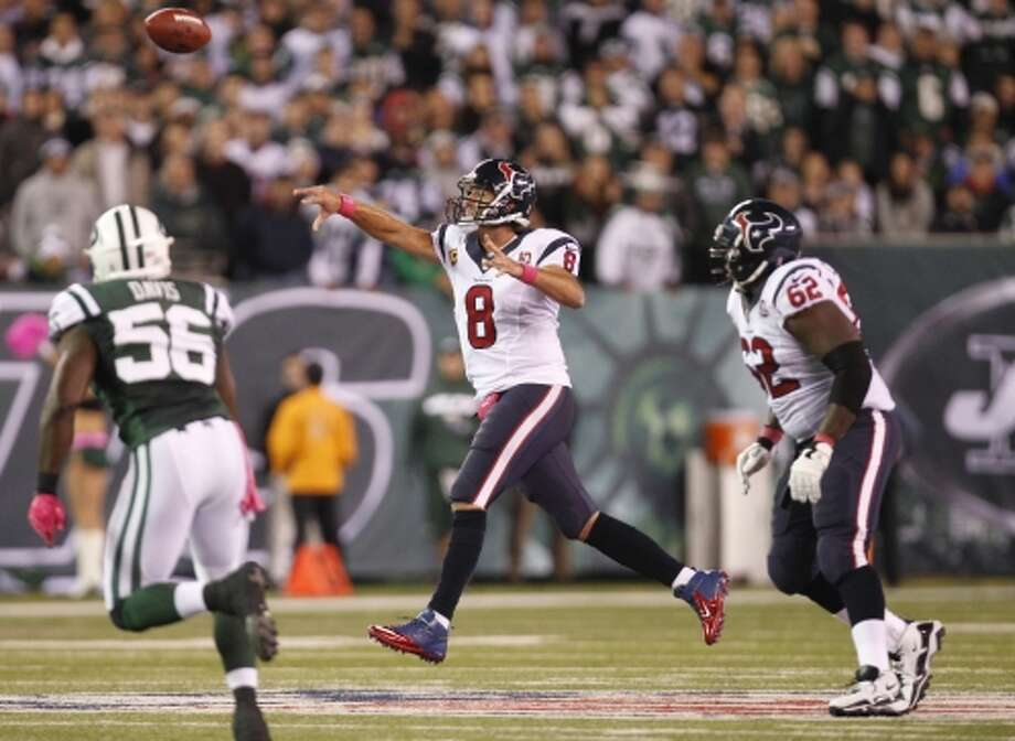 Texans quarterback Matt Schaub (8) tosses a pass against the Jets during the second quarter. (Houston Chronicle)