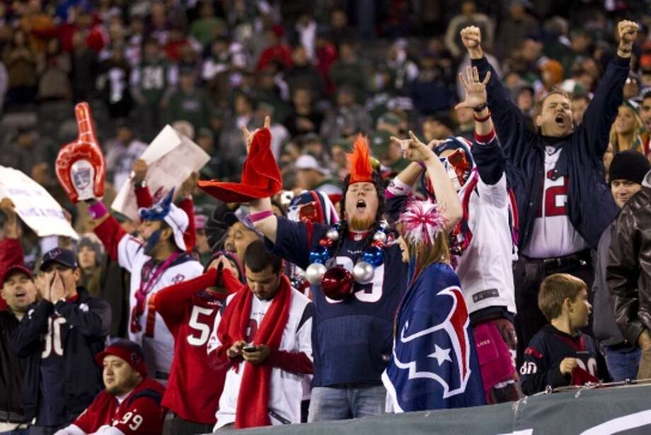 Texans fans cheer after the Texans beat the Jets. (Houston Chronicle)