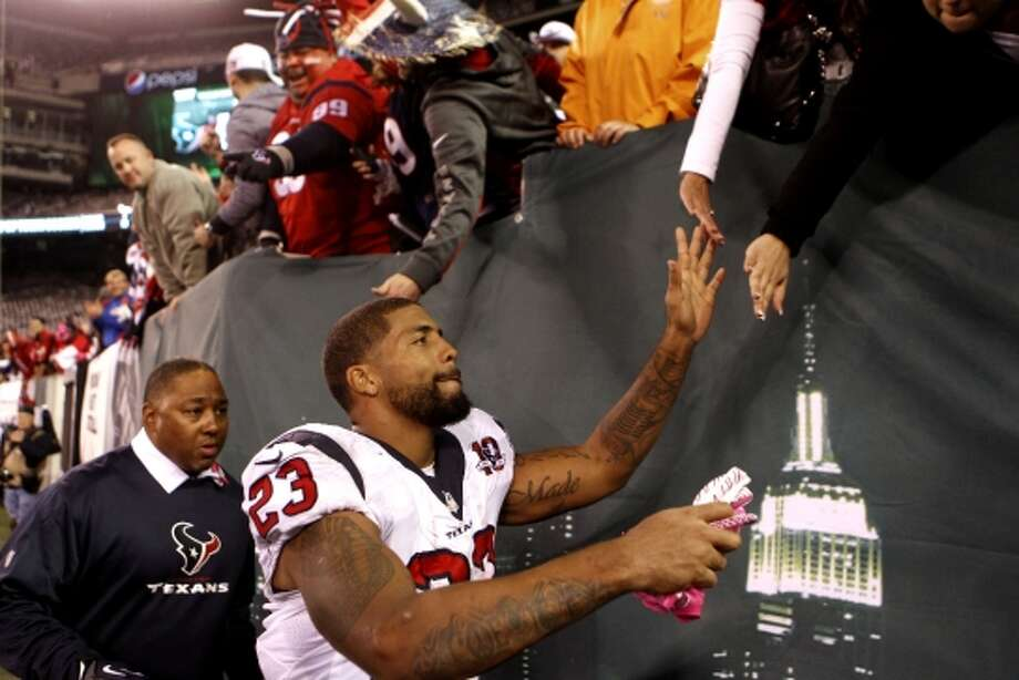 Texans running back Arian Foster high fives fans as he leaves the field after the Texans beat the New York Jets. (Houston Chronicle)