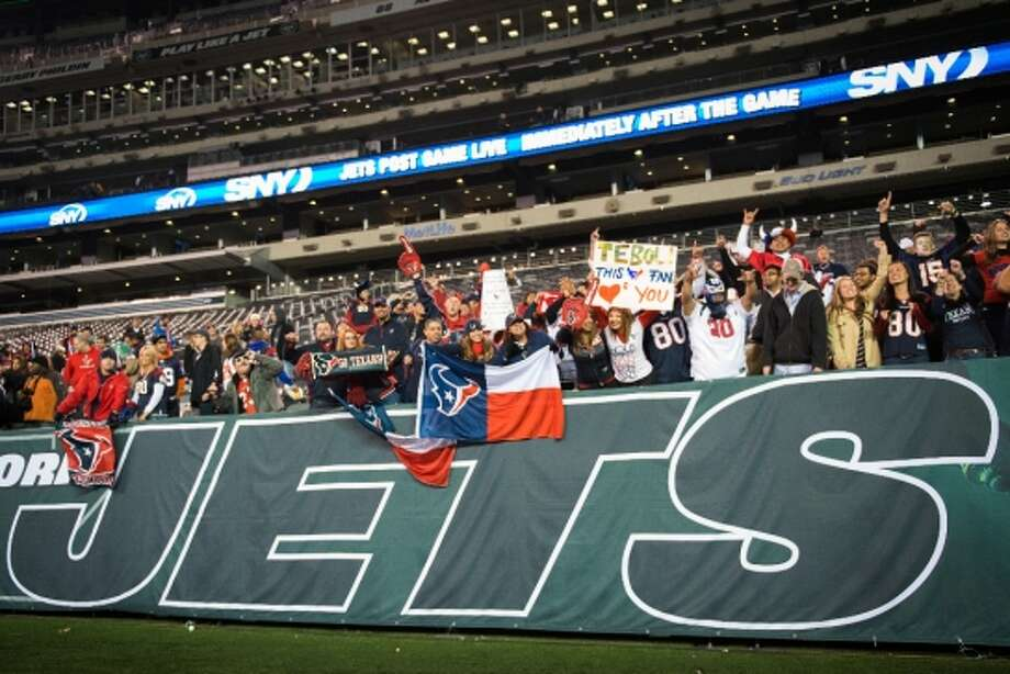 Texans fans celebrate after the Texans victory over the Jets. (Houston Chronicle)