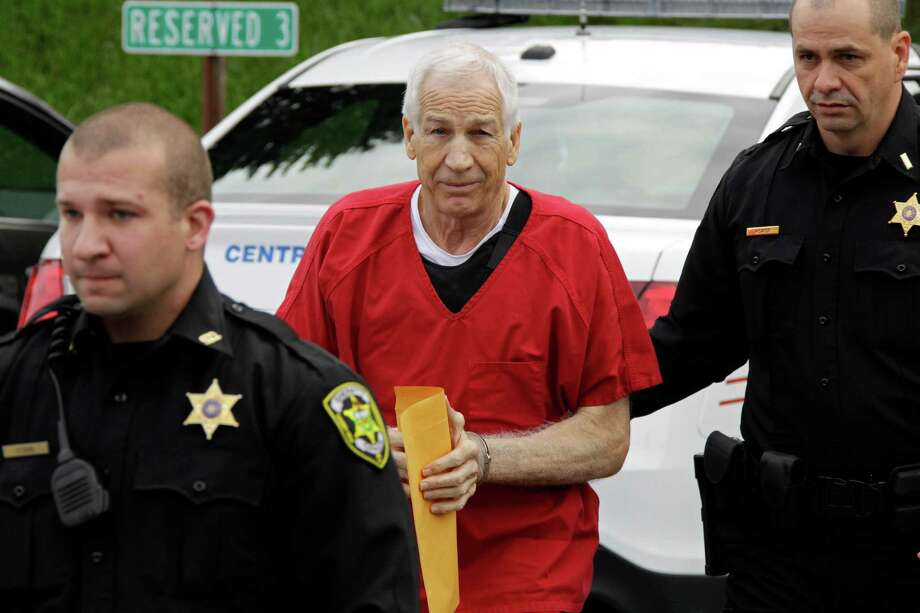Former Penn State University assistant football coach Jerry Sandusky, center,  arrives for sentencing at the Centre County Courthouse in Bellefonte, Pa., Tuesday, Oct. 9, 2012. Tuesday, Oct. 9, 2012. Sandusky was convicted of sexually abusing 10 boys in a scandal that rocked the university and brought down Hall of Fame coach Joe Paterno. (AP Photo/Gene J. Puskar) Photo: Gene J. Puskar, STF / AP