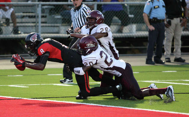 Memorial receiver John Leday fights for a touchdown during the Central vs. Memorial game Friday at Memorial Stadium in Port Arthur. Photo: Matt Billot