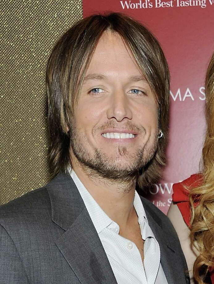 Keith Urban posed for Playgirl Magazine with nothing but his guitar before marrying Nicole Kidman. (Evan Agostini / AP) Photo: Evan Agostini, AP / AP2011