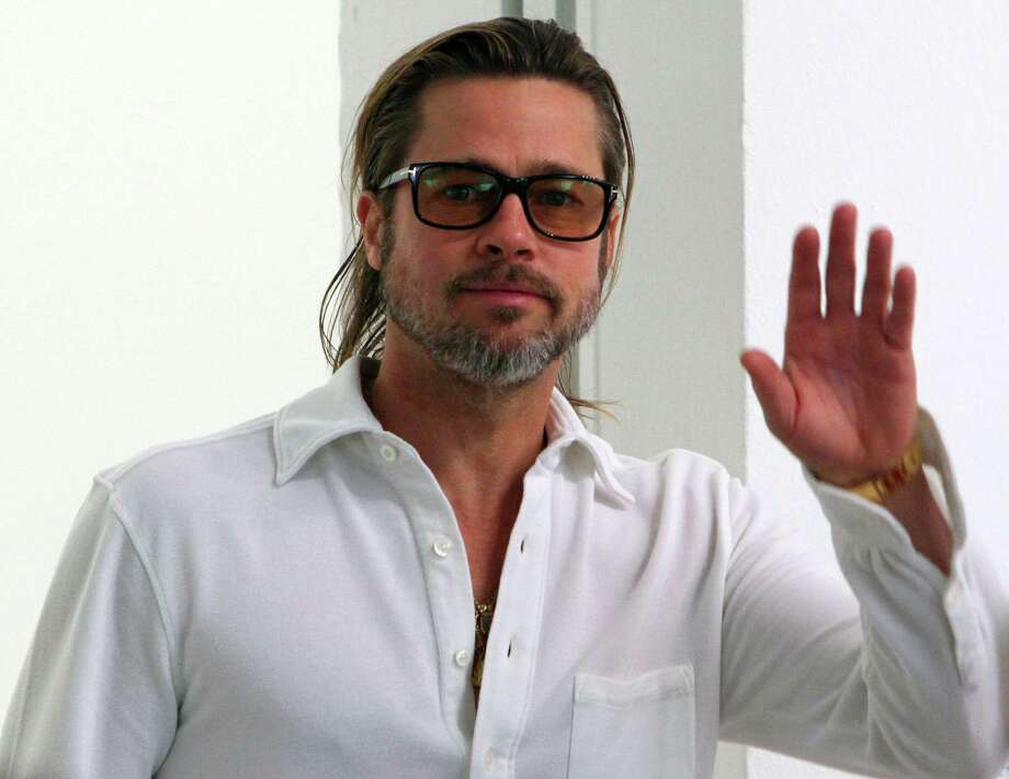 Brad Pitt appeared nude in Playgirl Magazine, but he didn't know he was posing. He said the photos were taken by a trespassing photographer and sued to have delivery of the edition stopped.  (Andreas Fischer / Associated Press) Photo: Andreas Fischer, Associated Press / dapd