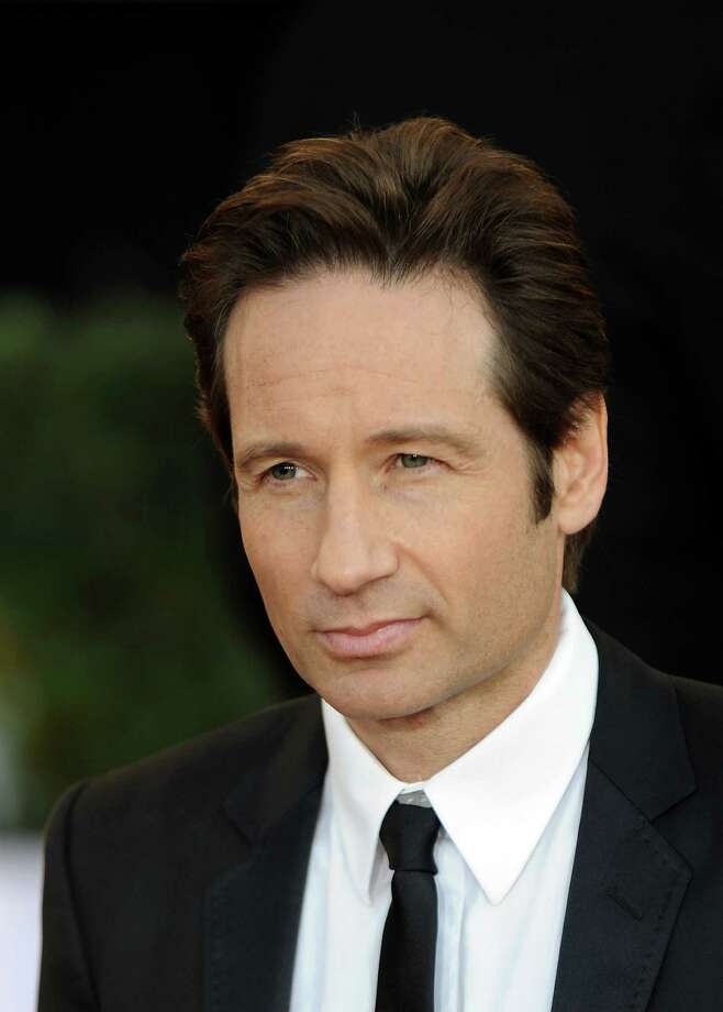 David Duchovny posed for Playgirl in oddly placed teapots before becoming a father and recovering sex addict. (JEWEL SAMAD / AFP/Getty Images) Photo: JEWEL SAMAD, AFP/Getty Images / AFP