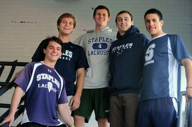 Staples High School lacrosse players, from left, James Hines, Joey Zelkowitz, Colin Bannon, Quinn Mendelson and Lance Lonergan, pose for a group portrait at the school in Westport. Photo: Autumn Driscoll / Connecticut Post