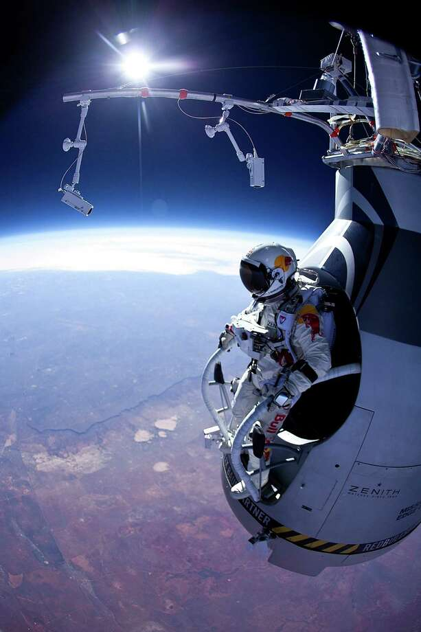 "Austrian Pilot Felix Baumgartner's ""Red Bull Stratos"" attempt to free fall from a record altitude of 120,000 feet was just delayed because of weather conditions. But Baumgartner has successfully completed many other feats, including this first manned test flight for Red Bull Stratos on March 15, 2012 in Roswell, New Mexico. In this test, he jumped from 71,500 feet. Photo: Handout, Getty Images / 2012 Red Bull"