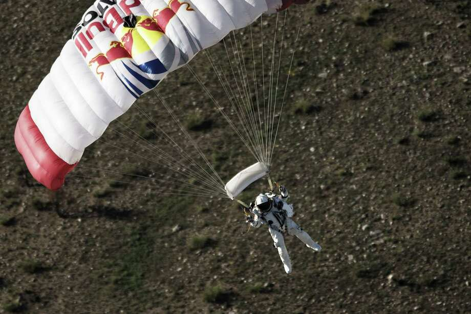 Felix Baumgartner lands in the desert during the second manned test flight for Red Bull Stratos in Roswell, N.M. on July 25, 2012. Photo: AFP, AFP/Getty Images / 2012 AFP