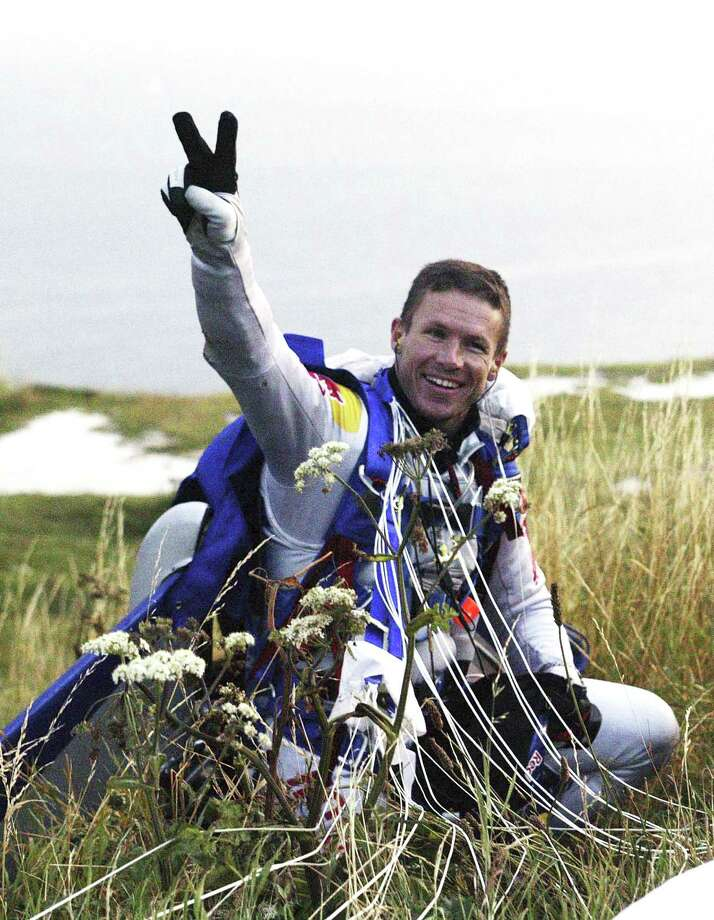 Felix Baumgartner gives a peace sign after his successful freefall across the English Channel between Dover and Calais on July 31, 2003. Photo: Getty Images / 2003 Getty Images