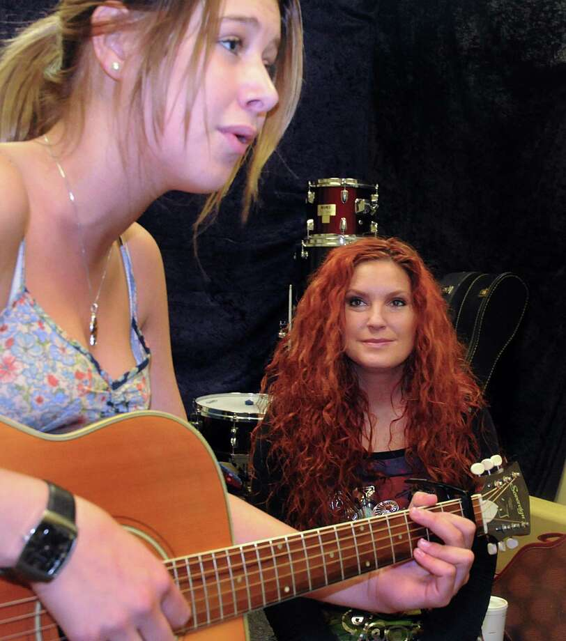 Sarah Kelly listens as Sophia Andersson, of Sweden, performs a song. Photo: David Hopper / freelance