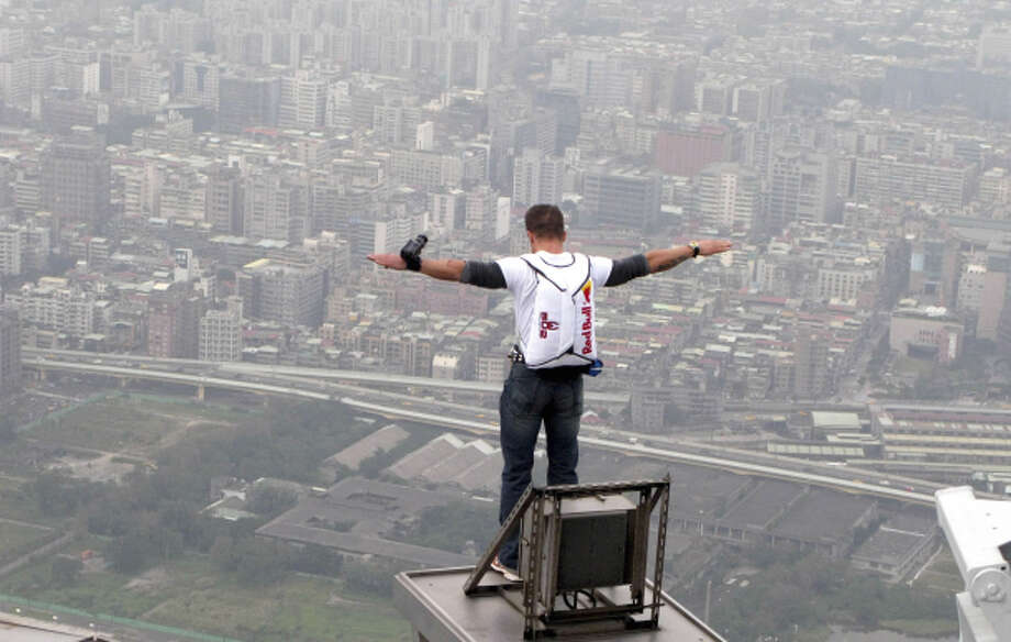 Felix Baumgartner prepares to jump from the Taipei 101 tower in 2007, in Taipei, Taiwan. It was the world's tallest building at the time. Photo: Red Bull