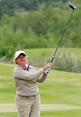 Mary Petrovich credits her successful business and golf careers to opportunities provided through her work as a caddie as a 12-year-old. Photo: Edward A. Ornelas, San Antonio Express-News / © 2012 San Antonio Express-News