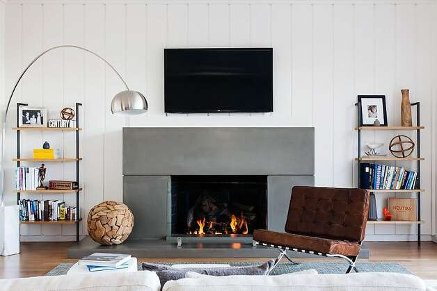 The living room boasts a custom-designed fireplace. Photo: Catherine Nguyen