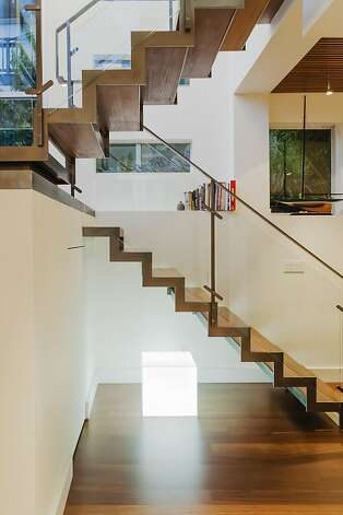 A unique lighting fixture is situated under the staircase. Photo: Catherine Nguyen