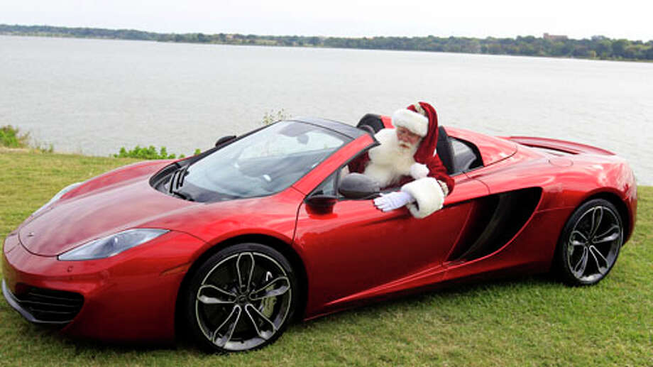 Brady White portrays Santa Claus as he shows off a 2013 McLaren 12C spider sports car during the unveiling of the Neiman Marcus 2012 Christmas Book in Dallas, Tuesday, Oct. 9, 2012.  The Neiman Marcus edition is one of 12 made and priced at $354,000. Photo: LM Otero, . / AP