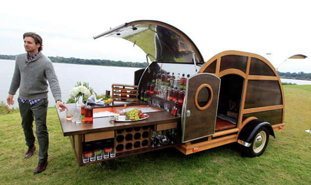 A model displays the Bulleit Frontier Whisky Woody-Tailgate Trailer during the unveiling of the Neiman Marcus 2012 Christmas Book in Dallas, Tuesday, Oct. 9, 2012.  The trailer is priced for sale at $150,000. Photo: LM Otero, . / AP