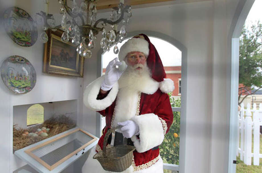 Santa Claus, portrayed by Brady White, gathers an egg from the Heritage Hen House Mini Farm on display during the unveiling of the Neiman Marcus 2012 Christmas Book in Dallas, Tuesday, Oct. 9, 2012. The Versailles-inspired Le Petit Trianon house including the chandelier in the hen house is priced for sale at $100,000. Photo: LM Otero, . / AP