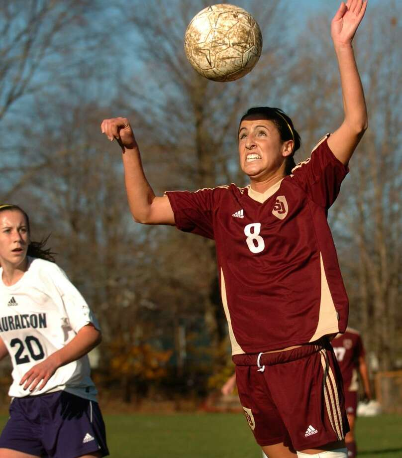 St. Joseph's Jessica Schloth heads the ball  as Lauralton Hall's Nicole Peterson looks on during Monday's Class M state tournament game at Lauralton Hall in Milford. St. Joseph won the game 2-0. Photo: Brian A. Pounds / Connecticut Post