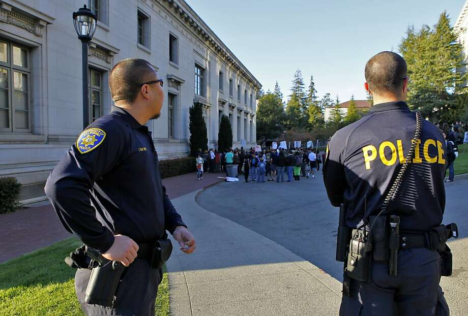 In this file photo, UC Berkeley Police officers stand guard near a students protest on campus. A veteran UC Berkeley police officer accidentally shot himself in the  leg Tuesday morning and is recovering from the injury,  authorities said. Photo: Lacy Atkins, The Chronicle